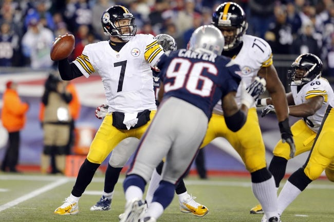 Nov 3, 2013; Foxborough, MA, USA; Pittsburgh Steelers quarterback Ben Roethlisberger (7) throws a pass against the New England Patriots in the in the second half at Gillette Stadium. The Patriots defeated the Steelers 55-31. Mandatory Credit: David Butler II-USA TODAY Sports