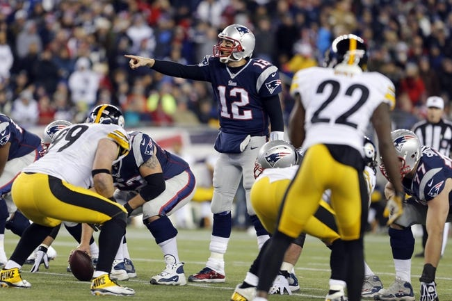 Nov 3, 2013; Foxborough, MA, USA; New England Patriots quarterback Tom Brady (12) calls out a play against the Pittsburgh Steelers in the second half at Gillette Stadium. The Patriots defeated the Steelers 55-31. Mandatory Credit: David Butler II-USA TODAY Sports
