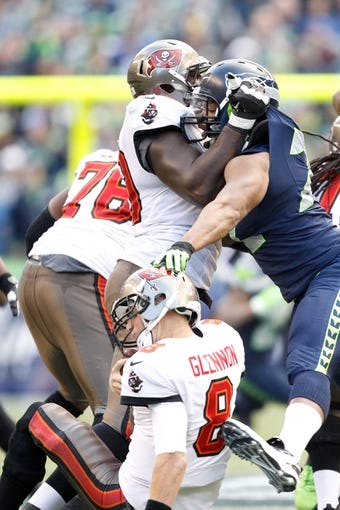 Nov 3, 2013; Seattle, WA, USA; Seattle Seahawks defensive end Michael Bennett (72) sacks Tampa Bay Buccaneers quarterback Mike Glennon (8) during the third quarter at CenturyLink Field. Mandatory Credit: Joe Nicholson-USA TODAY Sports