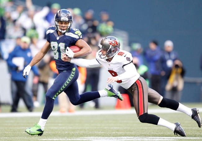 Nov 3, 2013; Seattle, WA, USA; Seattle Seahawks wide receiver Golden Tate (81) dodges a strip attempt by Tampa Bay Buccaneers punter Michael Koenen (9) during the third quarter at CenturyLink Field. Mandatory Credit: Joe Nicholson-USA TODAY Sports