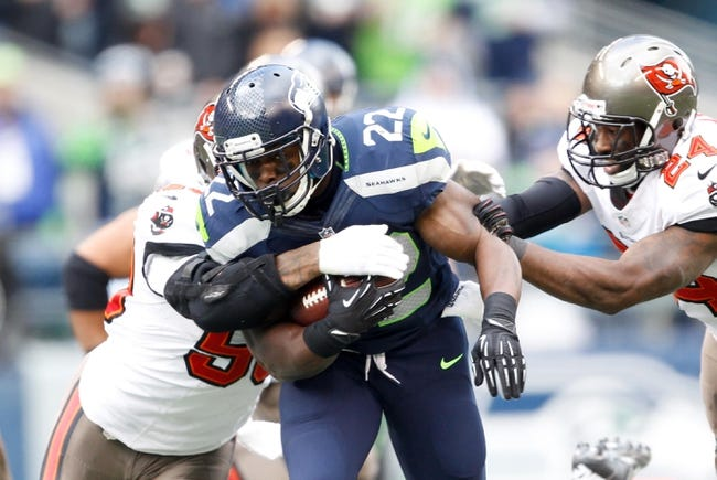 Nov 3, 2013; Seattle, WA, USA; Seattle Seahawks running back Robert Turbin (22) rushes against Tampa Bay Buccaneers cornerback Darrelle Revis (24) during the second half at CenturyLink Field. Mandatory Credit: Joe Nicholson-USA TODAY Sports