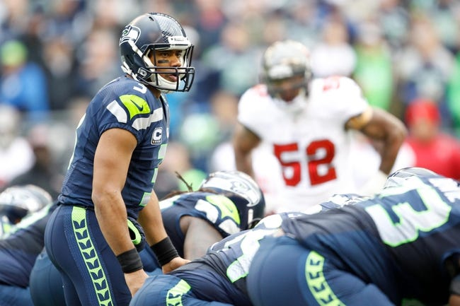 Nov 3, 2013; Seattle, WA, USA; Seattle Seahawks quarterback Russell Wilson (3) calls a an audible from the line against the Tampa Bay Buccaneers during the third quarter at CenturyLink Field. Mandatory Credit: Joe Nicholson-USA TODAY Sports