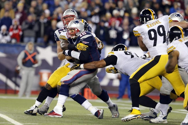 Nov 3, 2013; Foxborough, MA, USA; New England Patriots quarterback Tom Brady (12) is sacked by Pittsburgh Steelers outside linebacker Jason Worilds (93) in the second half at Gillette Stadium. The Patriots defeated the Steelers 55-31. Mandatory Credit: David Butler II-USA TODAY Sports