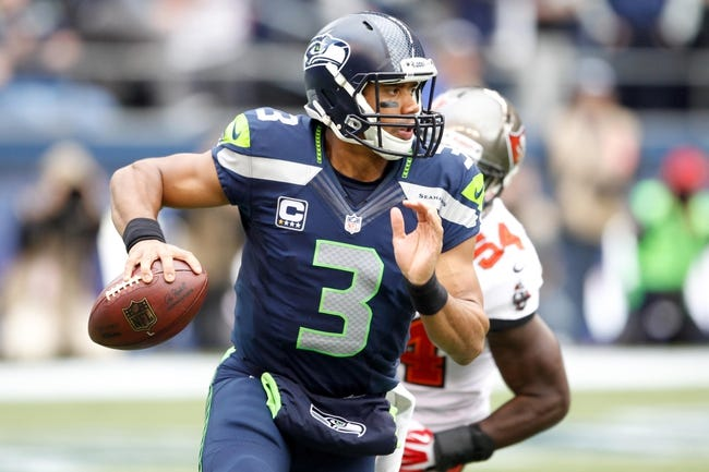 Nov 3, 2013; Seattle, WA, USA; Seattle Seahawks quarterback Russell Wilson (3) looks to pass against the Tampa Bay Buccaneers during the third quarter at CenturyLink Field. Mandatory Credit: Joe Nicholson-USA TODAY Sports
