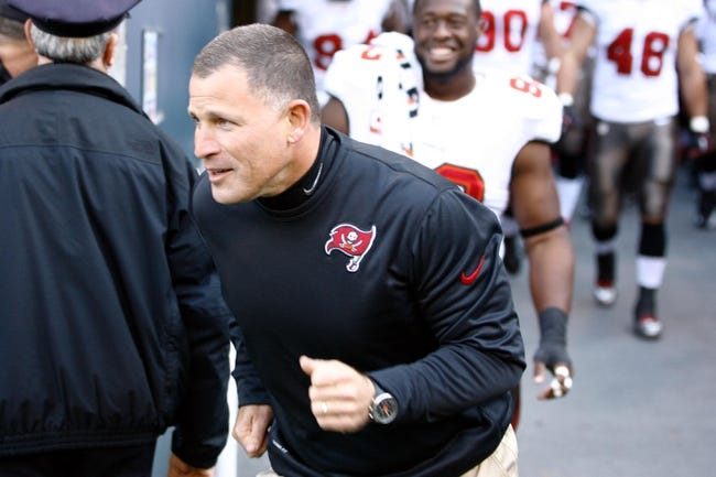 Nov 3, 2013; Seattle, WA, USA; Tampa Bay Buccaneers head coach Greg Schiano leads his team on to the field  before a game against the Seattle Seahawks at CenturyLink Field. Mandatory Credit: Joe Nicholson-USA TODAY Sports