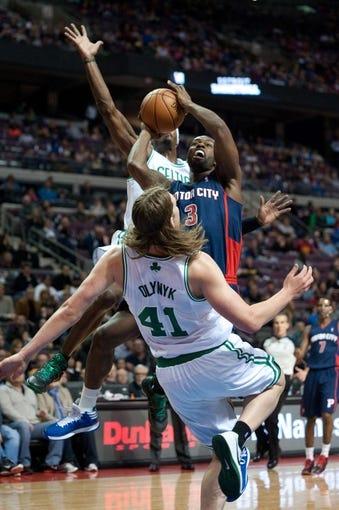 Nov 3, 2013; Auburn Hills, MI, USA; Detroit Pistons shooting guard Rodney Stuckey (3) fouls Boston Celtics power forward Kelly Olynyk (41) during the fourth quarter at The Palace of Auburn Hills. Detroit won 87-77. Mandatory Credit: Tim Fuller-USA TODAY Sports