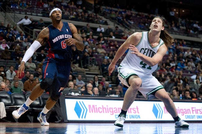 Nov 3, 2013; Auburn Hills, MI, USA; Boston Celtics power forward Kelly Olynyk (41) and Detroit Pistons small forward Josh Smith (6) battle for position under the basket during the game at The Palace of Auburn Hills. Detroit won 87-77. Mandatory Credit: Tim Fuller-USA TODAY Sports