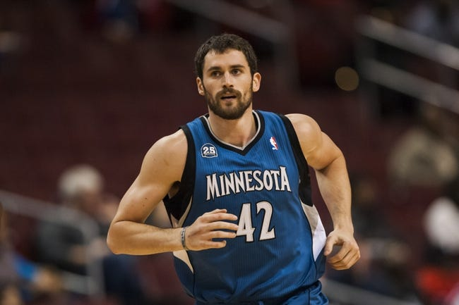 Oct 23, 2013; Philadelphia, PA, USA; Minnesota Timberwolves forward Kevin Love (42) during the first quarter against the Philadelphia 76ers at Wells Fargo Center. The Timberwolves defeated the Sixers 125-102. Mandatory Credit: Howard Smith-USA TODAY Sports