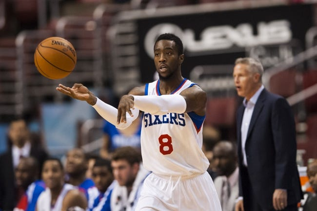 Oct 23, 2013; Philadelphia, PA, USA; Philadelphia 76ers guard Tony Wroten (8) passes the ball during the first quarter against the Minnesota Timberwolves at Wells Fargo Center. The Timberwolves defeated the Sixers 125-102. Mandatory Credit: Howard Smith-USA TODAY Sports