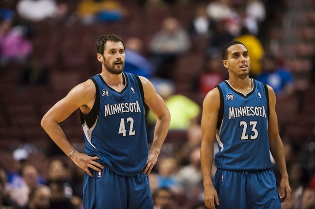 Oct 23, 2013; Philadelphia, PA, USA; Minnesota Timberwolves forward Kevin Love (42) and guard Kevin Martin (23) during the second quarter against the Philadelphia 76ers at Wells Fargo Center. The Timberwolves defeated the Sixers 125-102. Mandatory Credit: Howard Smith-USA TODAY Sports