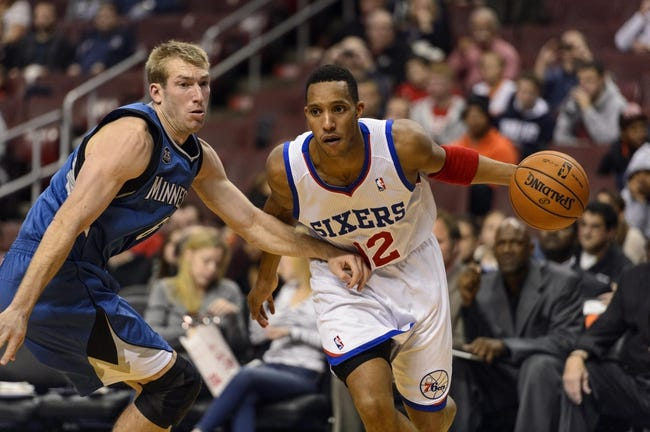 Oct 23, 2013; Philadelphia, PA, USA; Philadelphia 76ers guard Evan Turner (12) is defended by Minnesota Timberwolves forward Robbie Hummel (6) during the third quarter at Wells Fargo Center. The Timberwolves defeated the Sixers 125-102. Mandatory Credit: Howard Smith-USA TODAY Sports