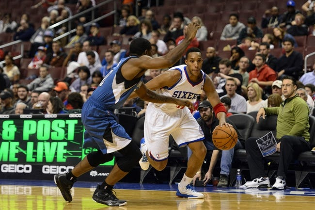 Oct 23, 2013; Philadelphia, PA, USA; Philadelphia 76ers guard Evan Turner (12) is defended by Minnesota Timberwolves guard Othyus Jeffers (12) during the third quarter at Wells Fargo Center. The Timberwolves defeated the Sixers 125-102. Mandatory Credit: Howard Smith-USA TODAY Sports