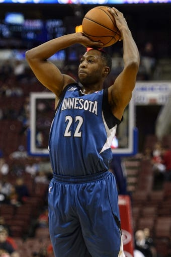 Oct 23, 2013; Philadelphia, PA, USA; Minnesota Timberwolves guard A.J. Price (22) shoots a jump shot during the fourth quarter against the Philadelphia 76ers at Wells Fargo Center. The Timberwolves defeated the Sixers 125-102. Mandatory Credit: Howard Smith-USA TODAY Sports