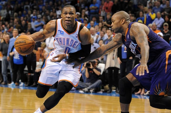 Nov 3, 2013; Oklahoma City, OK, USA; Oklahoma City Thunder point guard Russell Westbrook (0) handles the ball against Phoenix Suns small forward P.J. Tucker (17) during the fourth quarter at Chesapeake Energy Arena. Mandatory Credit: Mark D. Smith-USA TODAY Sports