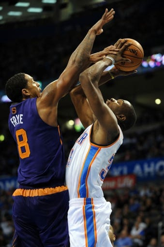 Nov 3, 2013; Oklahoma City, OK, USA; Oklahoma City Thunder small forward Kevin Durant (35) attempts a shot against Phoenix Suns power forward Channing Frye (8) during the fourth quarter at Chesapeake Energy Arena. Mandatory Credit: Mark D. Smith-USA TODAY Sports