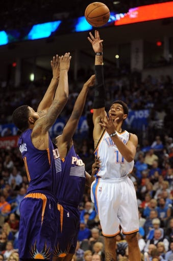 Nov 3, 2013; Oklahoma City, OK, USA; Oklahoma City Thunder shooting guard Jeremy Lamb (11) attempts a shot against Phoenix Suns power forward Markieff Morris (11) during the third quarter at Chesapeake Energy Arena. Mandatory Credit: Mark D. Smith-USA TODAY Sports
