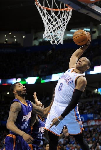 Nov 3, 2013; Oklahoma City, OK, USA; Oklahoma City Thunder point guard Russell Westbrook (0) attempts a shot against Phoenix Suns power forward Markieff Morris (11) during the fourth quarter at Chesapeake Energy Arena. Mandatory Credit: Mark D. Smith-USA TODAY Sports