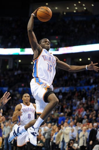 Nov 3, 2013; Oklahoma City, OK, USA; Oklahoma City Thunder point guard Reggie Jackson (15) attempts a shot against the Phoenix Suns during the third quarter at Chesapeake Energy Arena. Mandatory Credit: Mark D. Smith-USA TODAY Sports