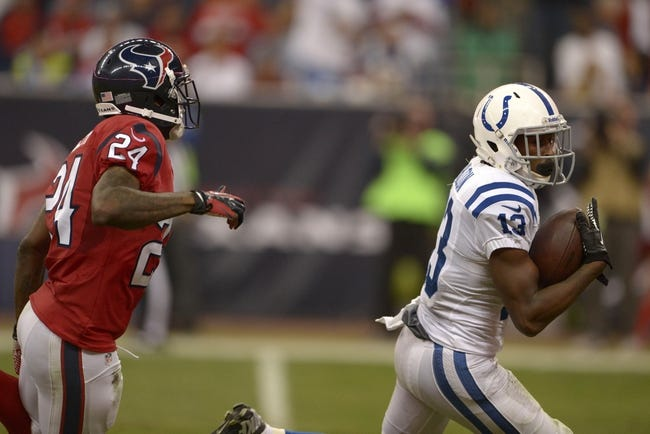 Nov 3, 2013; Houston, TX, USA; Indianapolis Colts wide receiver T.Y. Hilton (13) catches a pass for a touchdown against Houston Texans cornerback Johnathan Joseph (24) during the second half at Reliant Stadium. The Colts won 27-24. Mandatory Credit: Thomas Campbell-USA TODAY Sports