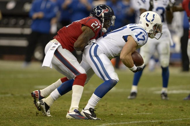 Nov 3, 2013; Houston, TX, USA; Houston Texans cornerback Brice McCain (21) tackles Indianapolis Colts wide receiver Griff Whalen (17) during the second half at Reliant Stadium. The Colts won 27-24. Mandatory Credit: Thomas Campbell-USA TODAY Sports