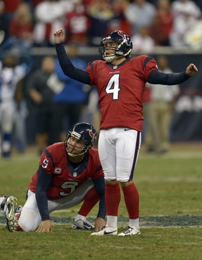 Nov 3, 2013; Houston, TX, USA; Houston Texans kicker Randy Bullock (4) watches his potentially game-tying field goal attempt miss against the Indianapolis Colts during the second half at Reliant Stadium. The Colts won 27-24. Mandatory Credit: Thomas Campbell-USA TODAY Sports