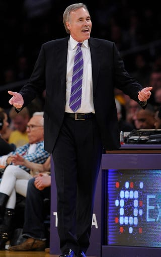 Nov 3, 2013; Los Angeles, CA, USA; Los Angeles Lakers head coach Mike D'Antoni complains about a foul call during the second half against Atlanta Hawks at Staples Center. Mandatory Credit: Robert Hanashiro-USA TODAY Sports