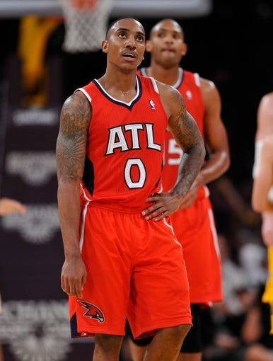 Nov 3, 2013; Los Angeles, CA, USA; Atlanta Hawks point guard Jeff Teague (0) reacts to turning the ball over during the closing seconds against the Los Angeles Lakers at Staples Center. The Lakers went on to win 105-103. Mandatory Credit: Robert Hanashiro-USA TODAY Sports