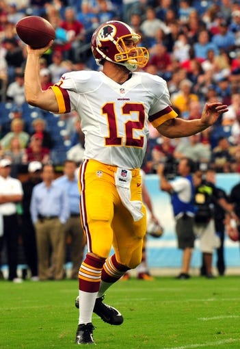 Aug 8, 2013; Nashville, TN, USA; Washington Redskins quarterback Kirk Cousins (12) throws for a touchdown against the Tennessee Titans during the first half at LP Field. Mandatory Credit: Don McPeak-USA TODAY Sports