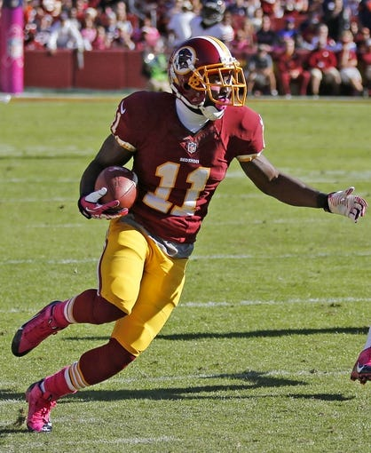 Oct 20, 2013; Landover, MD, USA; Washington Redskins wide receiver Aldrick Robinson (11) runs with the ball during the game against the Chicago Bears at FedEx Field. The Redskins won 45-41. Mandatory Credit: Geoff Burke-USA TODAY Sports