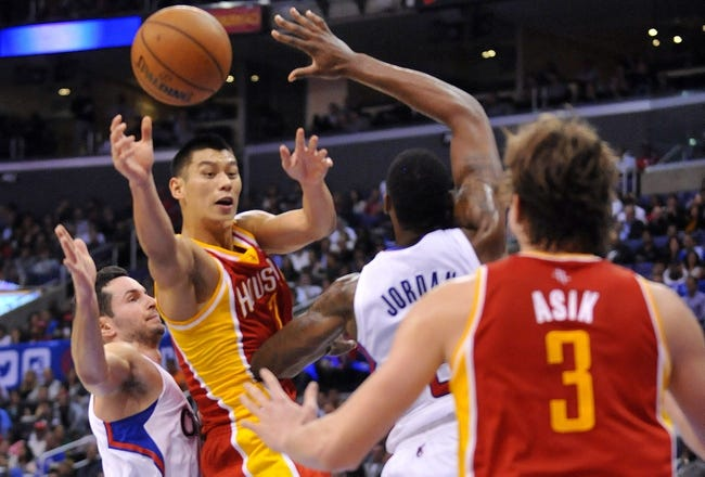 November 4, 2013; Los Angeles, CA, USA; Houston Rockets point guard Jeremy Lin (7) passes the ball against the Los Angeles Clippers defense during the first half at Staples Center. Mandatory Credit: Gary A. Vasquez-USA TODAY Sports