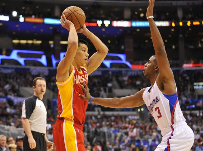 November 4, 2013; Los Angeles, CA, USA; Houston Rockets point guard Jeremy Lin (7) controls the ball against the defense of Los Angeles Clippers point guard Chris Paul (3) during the first half at Staples Center. Mandatory Credit: Gary A. Vasquez-USA TODAY Sports