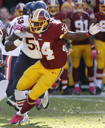 Oct 20, 2013; Landover, MD, USA; Washington Redskins defensive back Trenton Robinson (34) tackles in the fourth quarter against the Chicago Bears at FedEx Field. The Redskins won 45-41. Mandatory Credit: Geoff Burke-USA TODAY Sports