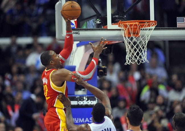 November 4, 2013; Los Angeles, CA, USA; Houston Rockets center Dwight Howard (12) goes in for a basket against Los Angeles Clippers during the second half at Staples Center. Mandatory Credit: Gary A. Vasquez-USA TODAY Sports