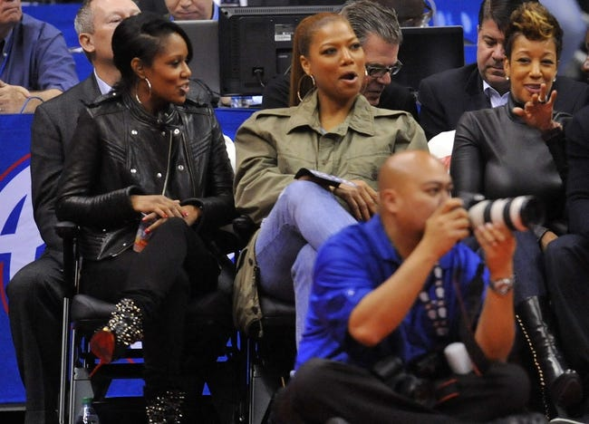 November 4, 2013; Los Angeles, CA, USA; Recording artist Queen Latifah (green jacket) in attendance watching the Houston Rockets play against Los Angeles Clippers during the second half at Staples Center. Mandatory Credit: Gary A. Vasquez-USA TODAY Sports