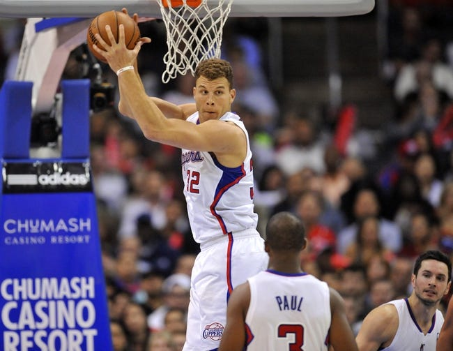 November 4, 2013; Los Angeles, CA, USA; Los Angeles Clippers power forward Blake Griffin (32) grabs a rebound against Houston Rockets during the second half at Staples Center. Mandatory Credit: Gary A. Vasquez-USA TODAY Sports