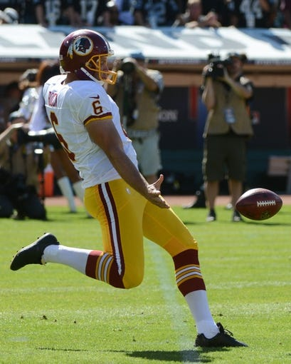 September 29, 2013; Oakland, CA, USA; Washington Redskins punter Sav Rocca (6) punts the football during the second quarter against the Oakland Raiders at O.co Coliseum. The Redskins defeated the Raiders 24-14. Mandatory Credit: Kyle Terada-USA TODAY Sports