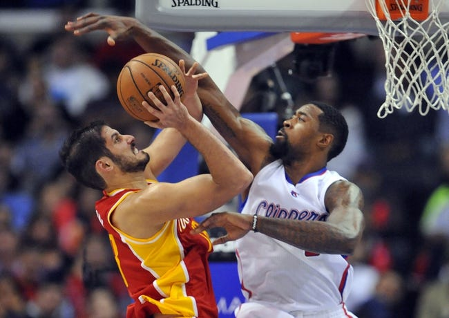 November 4, 2013; Los Angeles, CA, USA; Houston Rockets small forward Omri Casspi (18) moves to the basket against the defense of Los Angeles Clippers center DeAndre Jordan (6) during the second half at Staples Center. Mandatory Credit: Gary A. Vasquez-USA TODAY Sports
