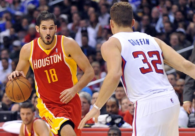 November 4, 2013; Los Angeles, CA, USA; Houston Rockets small forward Omri Casspi (18) moves the ball against the defense of Los Angeles Clippers power forward Blake Griffin (32) during the first half at Staples Center. Mandatory Credit: Gary A. Vasquez-USA TODAY Sports