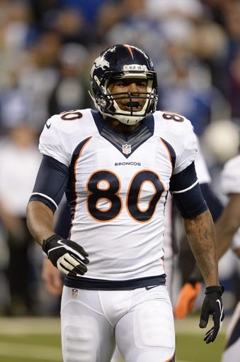 Oct 20, 2013; Indianapolis, IN, USA; Denver Broncos tight end Julius Thomas (80) leaves the field against the Indianapolis Colts at Lucas Oil Stadium. The Colts defeated the Broncos 39-33. Mandatory Credit: Ron Chenoy-USA TODAY Sports