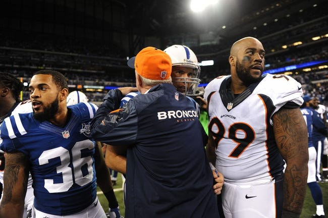 Oct 20, 2013; Indianapolis, IN, USA; Denver Broncos head coach John Fox greets Indianapolis Colts quarterback Andrew Luck (12) following the game at Lucas Oil Stadium. The Colts defeated the Broncos 39-33. Mandatory Credit: Ron Chenoy-USA TODAY Sports