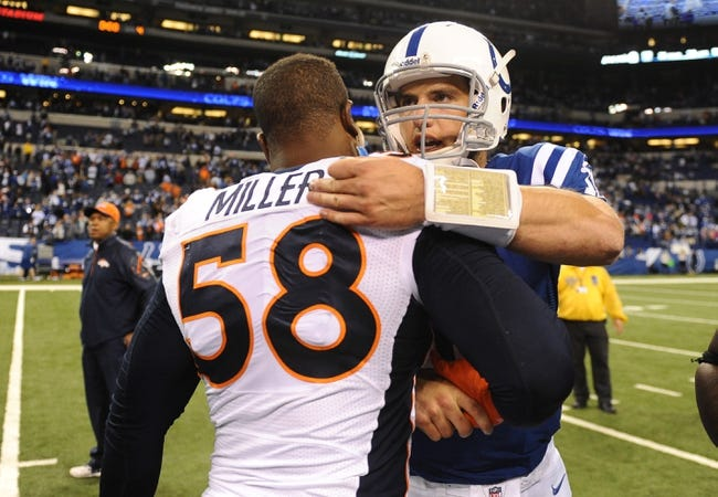 Oct 20, 2013; Indianapolis, IN, USA; Indianapolis Colts quarterback Andrew Luck (12) and Denver Broncos outside linebacker Von Miller (58) greet each other following the game at Lucas Oil Stadium. Mandatory Credit: The Colts defeated the Broncos 39-33. Mandatory Credit: Ron Chenoy-USA TODAY Sports