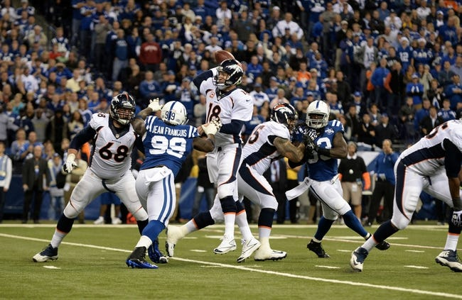 Oct 20, 2013; Indianapolis, IN, USA; Denver Broncos quarterback Peyton Manning (18) is hurried by Indianapolis Colts defensive end Ricky Jean Francois (99) and outside linebacker Erik Walden (93) as Broncos guard Zane Beadles (68) and tackle Chris Clark (75) pass protect at Lucas Oil Stadium. The Colts defeated the Broncos 39-33. Mandatory Credit: Ron Chenoy-USA TODAY Sports