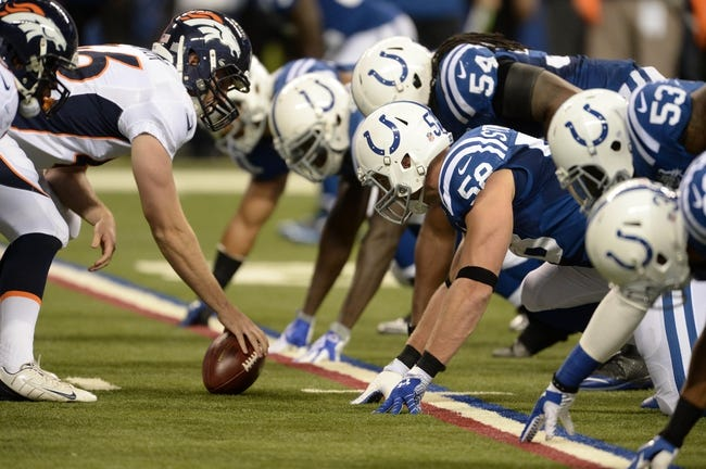 Oct 20, 2013; Indianapolis, IN, USA; Denver Broncos center Manny Ramirez (66) lines up across from Indianapolis Colts linebacker Andy Studebaker (58) at Lucas Oil Stadium. The Colts defeated the Broncos 39-33. Mandatory Credit: Ron Chenoy-USA TODAY Sports