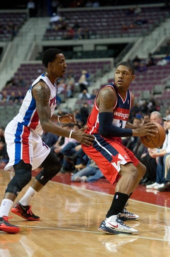 Oct 22, 2013; Auburn Hills, MI, USA; Detroit Pistons shooting guard Kentavious Caldwell-Pope (5) guards Washington Wizards shooting guard Bradley Beal (3) during the second quarter at The Palace of Auburn Hills. Mandatory Credit: Tim Fuller-USA TODAY Sports