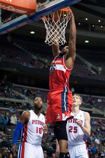 Oct 22, 2013; Auburn Hills, MI, USA; Washington Wizards power forward Trevor Booker (35) dunks during the first quarter against the Detroit Pistons at The Palace of Auburn Hills. Mandatory Credit: Tim Fuller-USA TODAY Sports