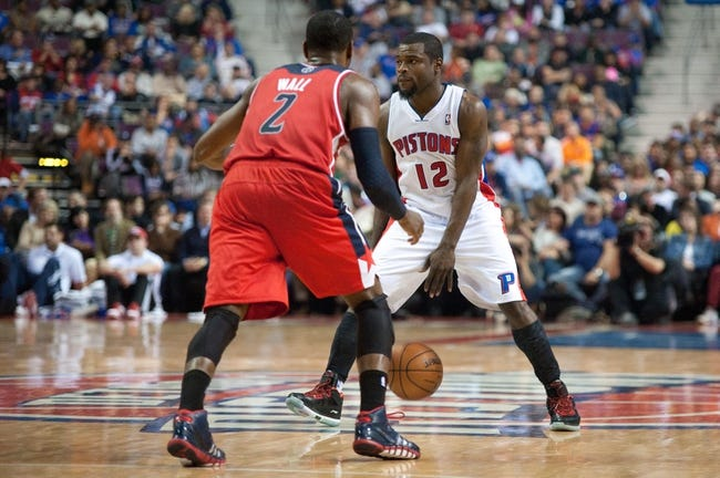 Oct 30, 2013; Auburn Hills, MI, USA; Washington Wizards point guard John Wall (2) guards Detroit Pistons point guard Will Bynum (12) during the third quarter at The Palace of Auburn Hills. Pistons won 113-102. Mandatory Credit: Tim Fuller-USA TODAY Sports