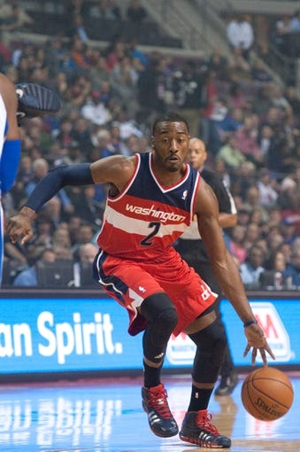 Oct 30, 2013; Auburn Hills, MI, USA; Washington Wizards point guard John Wall (2) drives to the basket during the first quarter against the Detroit Pistons at The Palace of Auburn Hills. Mandatory Credit: Tim Fuller-USA TODAY Sports