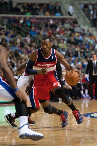 Oct 30, 2013; Auburn Hills, MI, USA; Washington Wizards point guard John Wall (2) drives to the basket against the Detroit Pistons during the second quarter at The Palace of Auburn Hills. Mandatory Credit: Tim Fuller-USA TODAY Sports