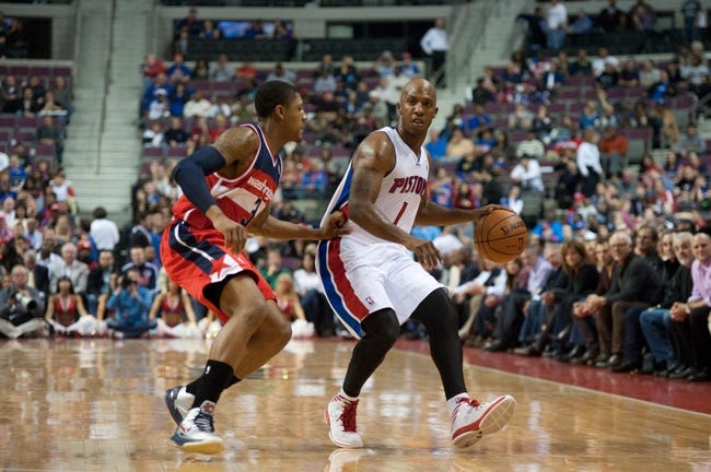 Oct 30, 2013; Auburn Hills, MI, USA; Washington Wizards shooting guard Bradley Beal (3) guards Detroit Pistons point guard Chauncey Billups (1) during the fourth quarter at The Palace of Auburn Hills. Pistons won 113-102. Mandatory Credit: Tim Fuller-USA TODAY Sports