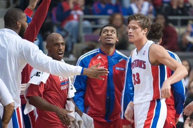 Oct 30, 2013; Auburn Hills, MI, USA; Detroit Pistons power forward Jonas Jerebko (33) is cheered on by teammates during the second quarter against the Washington Wizards at The Palace of Auburn Hills. Mandatory Credit: Tim Fuller-USA TODAY Sports